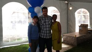 Three People Together in Outdoor Party Tent