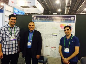 Isidore Rigoutsos, Aris Telonis, and Eric Londin Standing in Front of Poster Presentation at AACR 2015