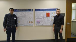 Two Men Standing in Front of SigmaXi Poster Presentations