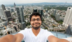 Kamlesh Ganesh Pawar Taking Selfie Overlooking a City
