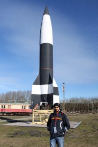 Kamlesh Ganesh Pawar Posing in Front of Rocket